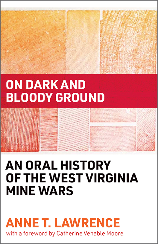 An Oral History of the West Virginia Mine Wars cover, wood grain print in red, orange, and yellow